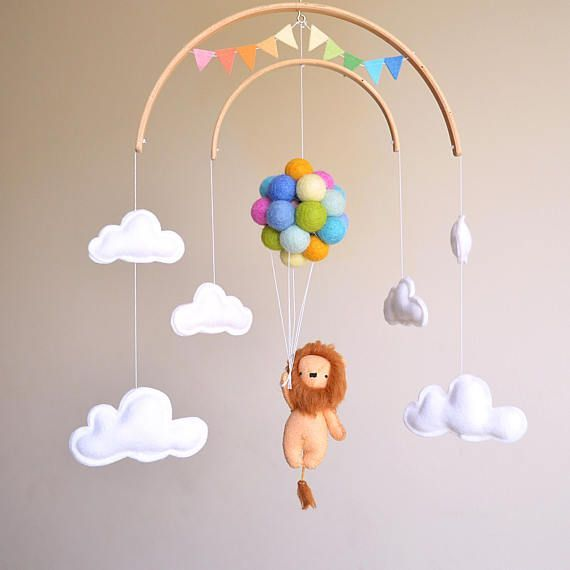 Baby mobile lion with pastel rainbow balloon …