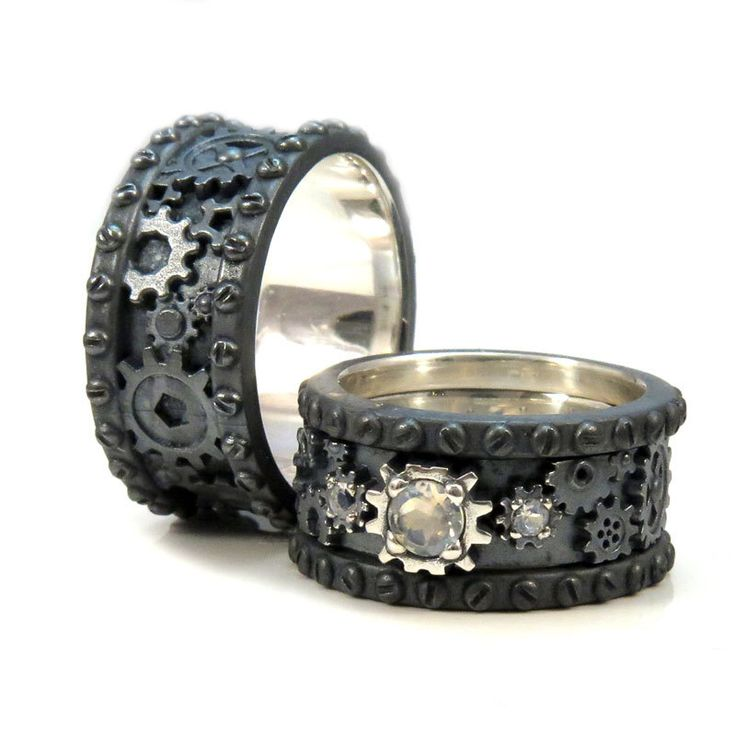 His and Hers Black Silver Gear Rings - Steampunk Wedding Ring Set - Faceted Moonstone Stacking Ladies by SwankMetalsmithing on Etsy https://www.etsy.com/listing/252421056/his-and-hers-black-silver-gear-rings