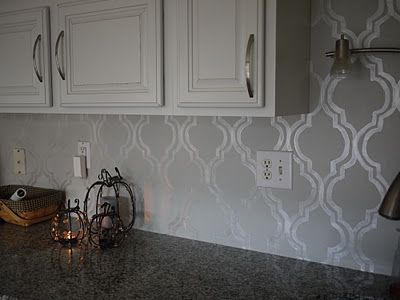 stencil backsplash using  martha stewart opalescent paint.