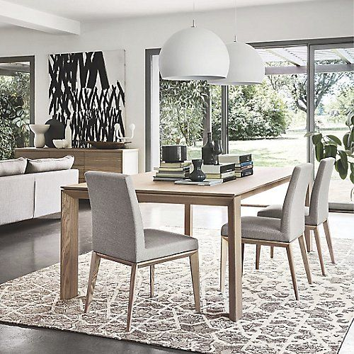 Meet all your modern dining needs with the Calligaris Omnia Wood Extension Table. In addition to its versatile all-wood construction and attractive perimeter-cut legs, the table can be extended to seat up to 12 people. Two of the legs have hidden castors that allow the table to be pulled apart smoothly and easily. The leaf slides out of its housing and lines up with the rest of the top.