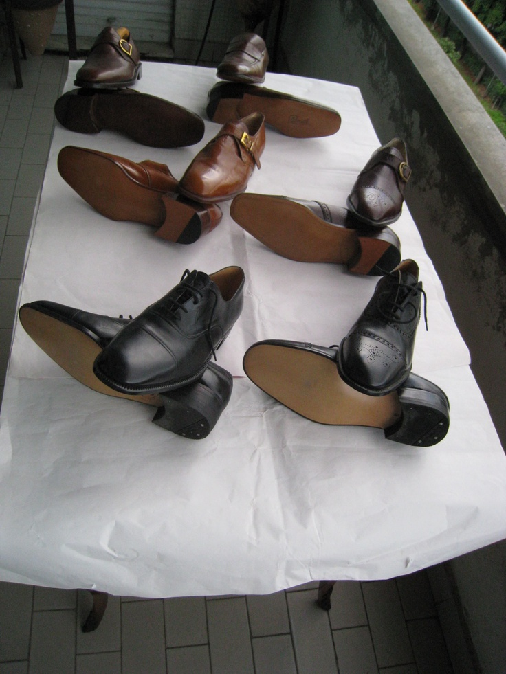 brown and black leather side buckle shoes and lace. English style