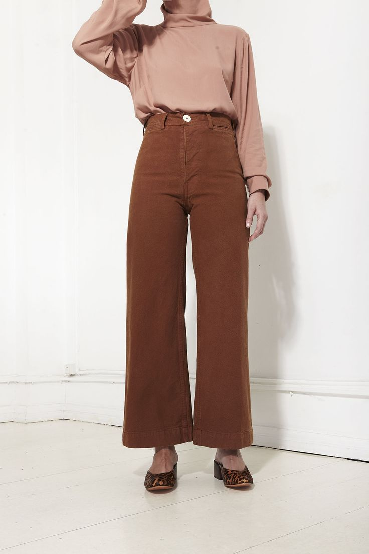 JESSE KAMM, Dusty rose draped turtleneck and rust brown high waist corduroy flared cropped trousers.