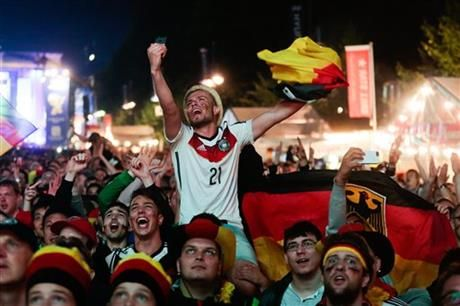 German fans react as they watch a live broadcast of the final match between Germany and Argentina at the soccer World Cup 2014 in Rio de Janeiro, Brazil, at a public viewing area called 'Fan Mile' in Berlin, Sunday, July 13, 2014. (AP Photo/Markus Schreiber) ▼13Jul2014AP Germany's World Cup party gets underway at home http://bigstory.ap.org/article/germans-already-gathering-watch-world-cup-final #Brazil2014 #Germany_Argentina_final