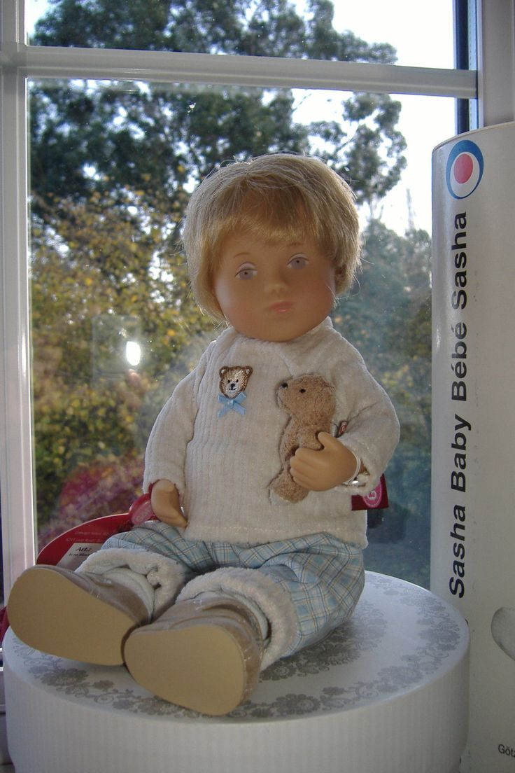 """From the later, lighter skinned Gotz collection. He's 12"""" tall has blonde hair and blue (almost lilac) eyes. Made in Germany. He is wearing a cream coloured corduroy top that has a bear sew on the front of it. 