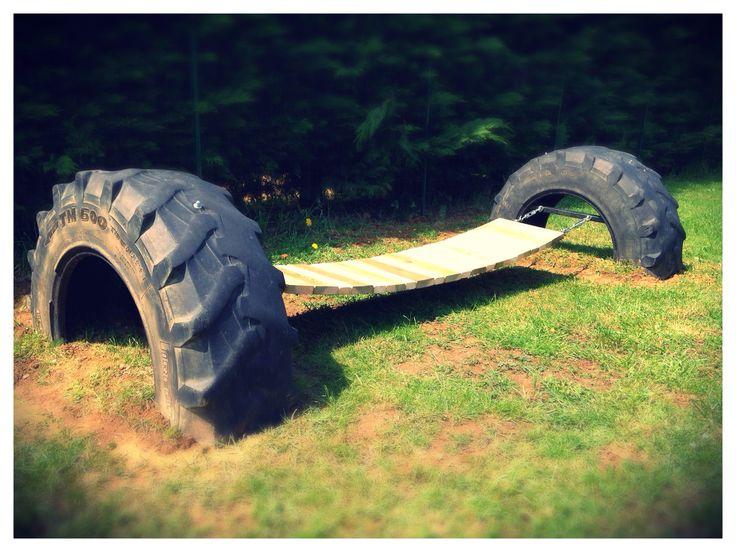 """A suspension bridge made with recycled pallet planks between two tractor tires ... Un pont suspendu réalisé avec des planches de palettes entre deux pneus de tracteur... [symple_box color=""""gray"""" fade_in=""""false"""" float=""""center"""" text_align=""""left"""" width=""""100%""""] Submitted by: Tessore Cecile ! [/symple_box]"""