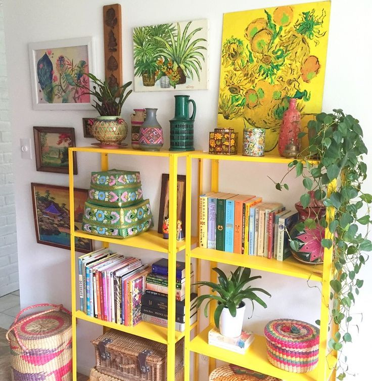 bright boho bookshelves, plants and botanical prints