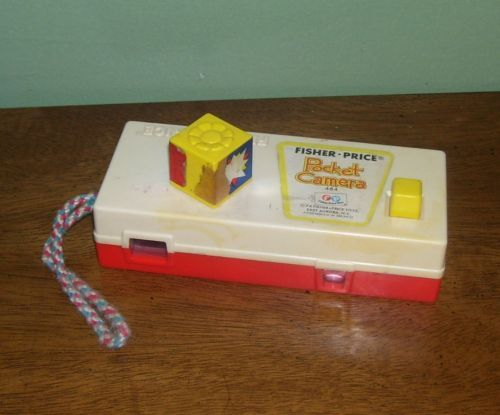 Vintage Fisher Price Pocket Camera 464 1974 1970's toy a trip to the zoo picture                      I do believe this was my daughters first camera!