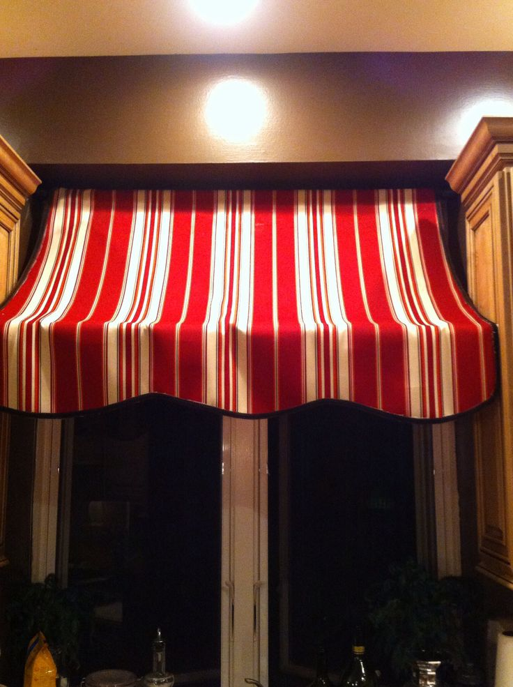 My Italian cafe kitchen curtain! Made for $13 from Joanne's Fabrics! Used one shower curtain pole up top and one expandable rod on the bottom!