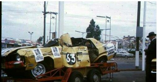 Bill Browns one hour old GTHO wrecked after rolling along the Armco railing on the top of Mt Panorama. Bathurst 1971.