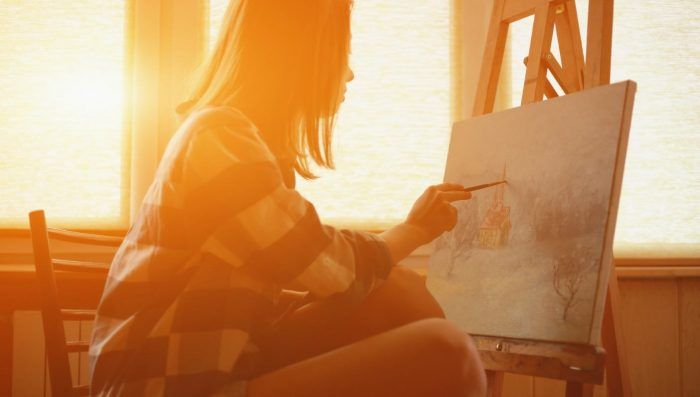 woman painting in the sunlight