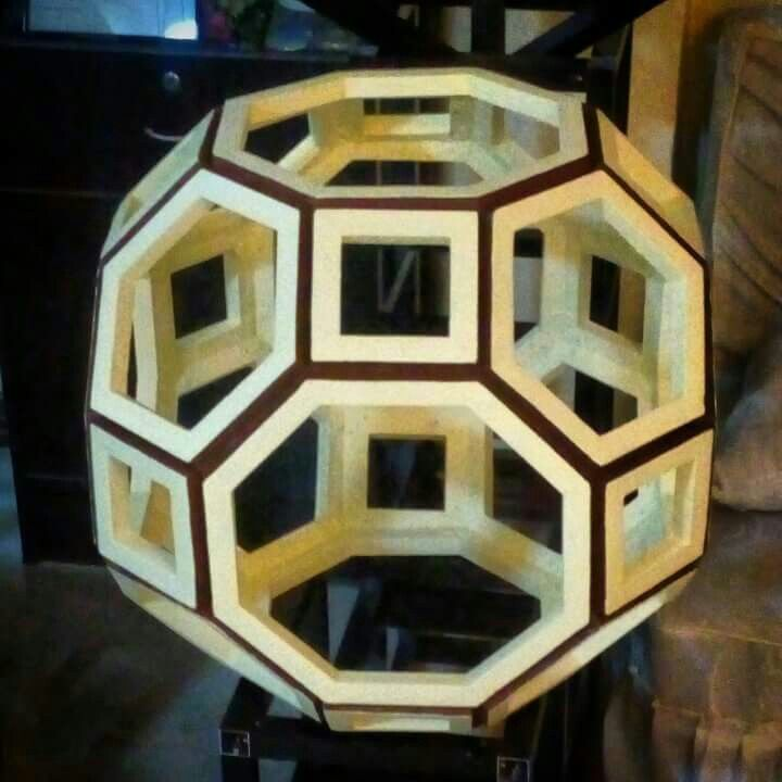 """FROM PAPER TO WOOD  Polyhedron # 14 - RHOMBITRUNCATED CUBOCTAHEDEON  Designed by Leo R. Natividad for Lights & Folds Handicraft  Fabricated by Allan Aguinaldo  Using 3/4""""×3/4""""×4.5"""" Softwood 12 Squares 8 Hexagons 6 Octagons 26 Surfaces  48 Apexes  72 Edges  Circumference - 66"""" (167.64 cm) Diameter - 21"""" (53.34 cm)  Price - Php 5,727.00  #from_paper_to_wood #only_in_the_world #origamipilipinas #lights_and_folds_handicraft #only_in_the_Philippines #origami_inspired_wooden_polyhedron"""