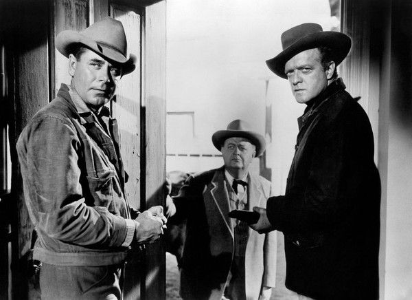Van Heflin and Glenn Ford....Two cowboy stars in the original western about the train to go to Yuma at the end.  (refer to new movie starred with Russell Crowe).