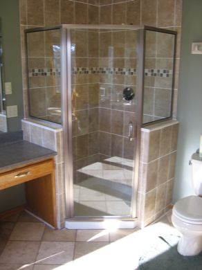 semi frameless neo angle shower enclosure with a 6 inch through-the-glass pull handle.