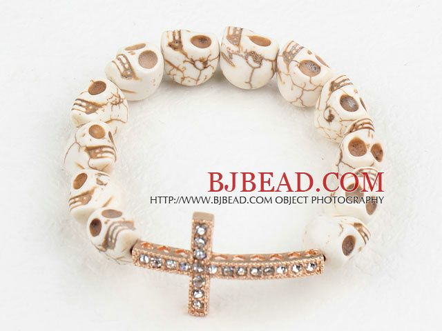 Gouden Kleur Rhinestone Sideway / Side Way Cross en Howliet Schedel Stretch armband