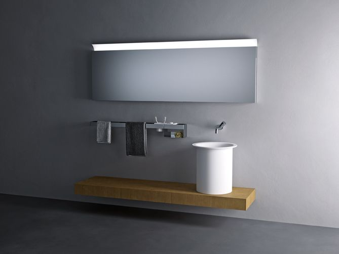 IN-OUT, 2010 - Benedini Associati | Made entirely in white Exmar, the In-Out washbasin is characterised by a wide circular basin, surrounded by a slim edge and supported by a cylindrical volume. Minimalist yet still a strong feature, the In-Out washbasin is available in different versions: wallmounted, corner, freestanding, on a top or recessed. In-Out, whether recessed or in the version for resting on a top