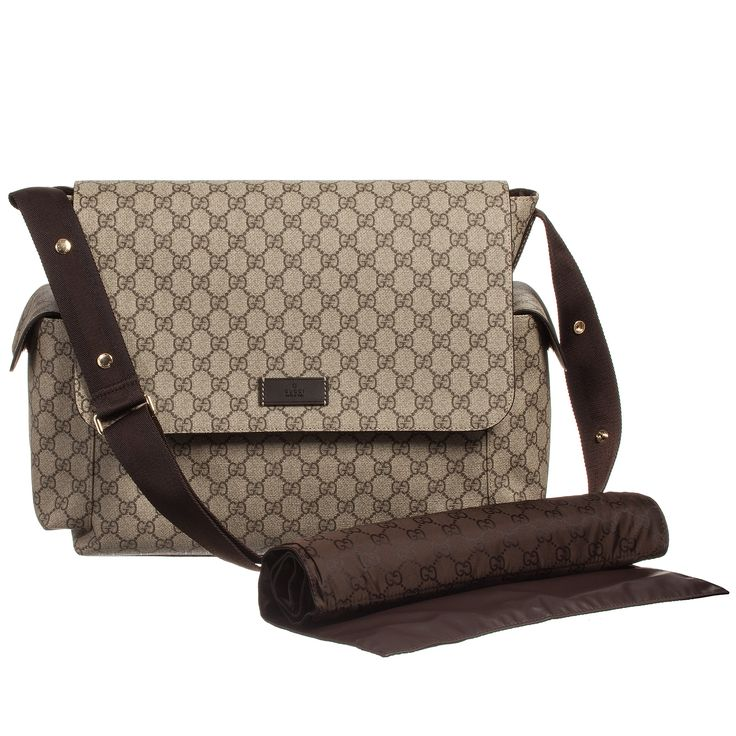 Pack all your baby changing essentials in Gucci's Supreme Canvas diaper bag. In beige, with an ebony and cocoa interlocking 'GG print. The bag has a velcro flap fastening, pouch pockets on the inside and one slide pocket. There are two end pockets on the outside with velcro fastening. The shoulder strap is webbed and leather trims, with buggy handles. Also included is a wipe clean padded changing mat.