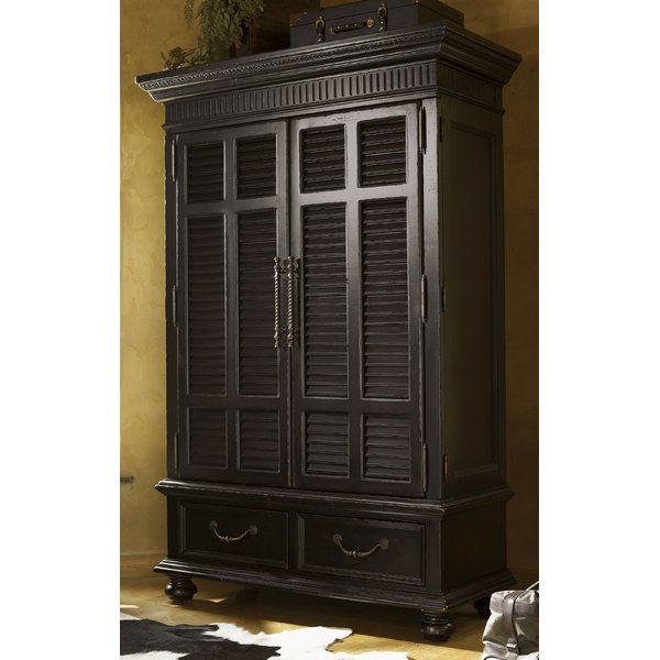 British Colonial and Campaign styling inspire the Kingstown Trafalgar Armoire with a relaxed traditional look. This armoire pays tribute to British Colonial antiques with louvered doors and a distinctively distressed finish. Wraparound doors open to reveal storage for clothing or media. It displays a timeworn look that guarantees a distinctive design with a sense of a well-traveled life.