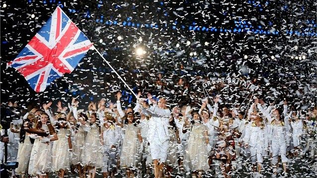 Sir Chris Hoy of the Great Britain Olympic cycling team carries his country's flag as he leads Great Britain
