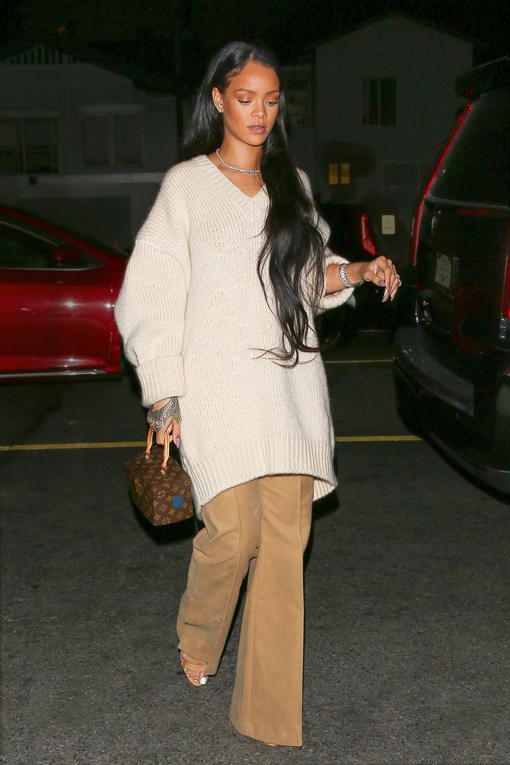 Rihanna Looks Prettier Than Ever in '70s-Inspired Flare Trousers and Cozy White Sweater from InStyle.com