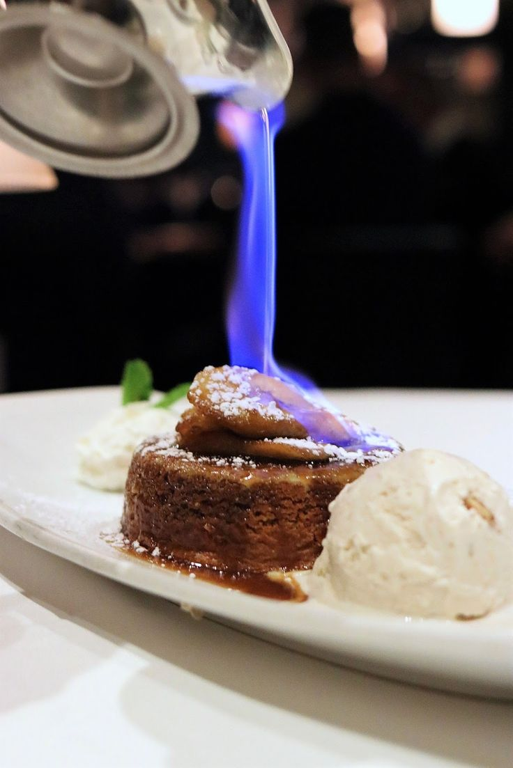 Eddie V's Prime Seafood | chicago foodie girl: Hot Bananas Foster Butter Cake flambeed tableside and served with a scoop of butter pecan ice cream