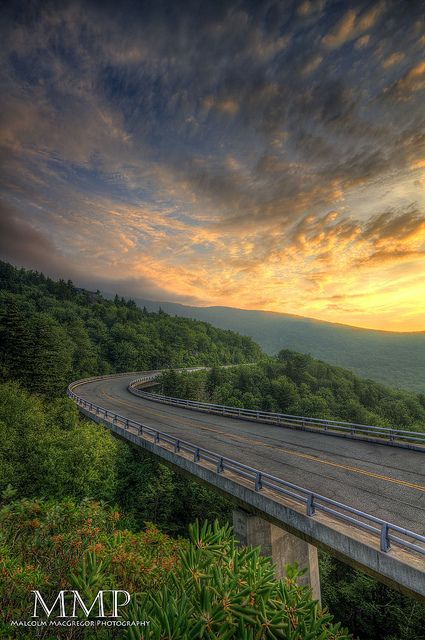 The Linn Cove Viaduct at milepost 304.6 (BRP, NC); the most complicated concrete bridge ever built.  Photo of: The Linn Cove Viaduct at Sunrise, by Malcolm MacGregor, via Flickr