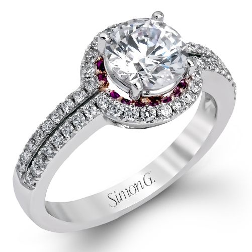 Passion Collection - This romantic 18K white and rose gold engagement ring is comprised of .41ctw white diamonds and a halo of .10ctw pink sapphires. - DR331