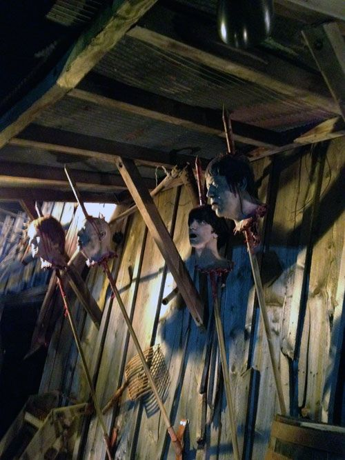 shed of skewered heads love it chicken coopsthe chickenmannequin headsbooth ideashead tohalloween diyscary halloween decorationsphoto