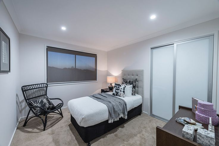 #Bedroom #interior #design #inspiration from #Ausbuild's Newbury display home. www.ausbuild.com.au. This #bedroom makes great use of all available space and features a #built-in #robe.