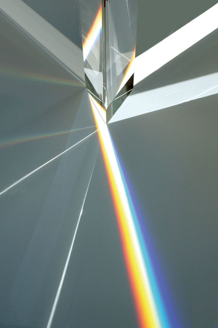 "Tokujin Yoshioka.""Rainbow Church"" The installation consists of a 9-metre window made of 500 crystal prisms, which create rainbows within the space as the light is refracted.The Artist Use passing light to create focussed beam. envision seeing this from the ground level so you are experiencing the light and only seeing a little bit of the geometric shape."