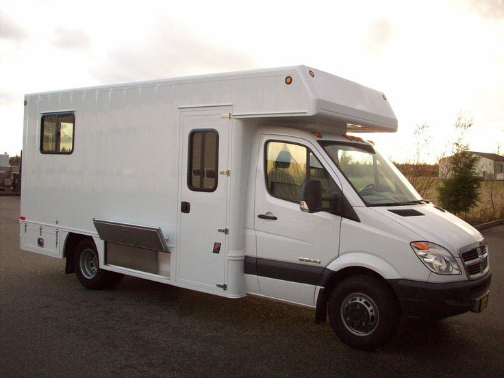 Side view of the custom TriVan Sprinter cube-body RV. Most ...