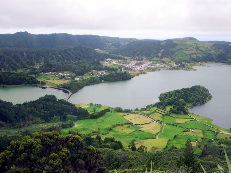 The bridge across Lagoa das Sete Cidades and the village of the same name as seen from the Miradouro do Cerrado das Freiras on Sao Miguel Island, Azores.