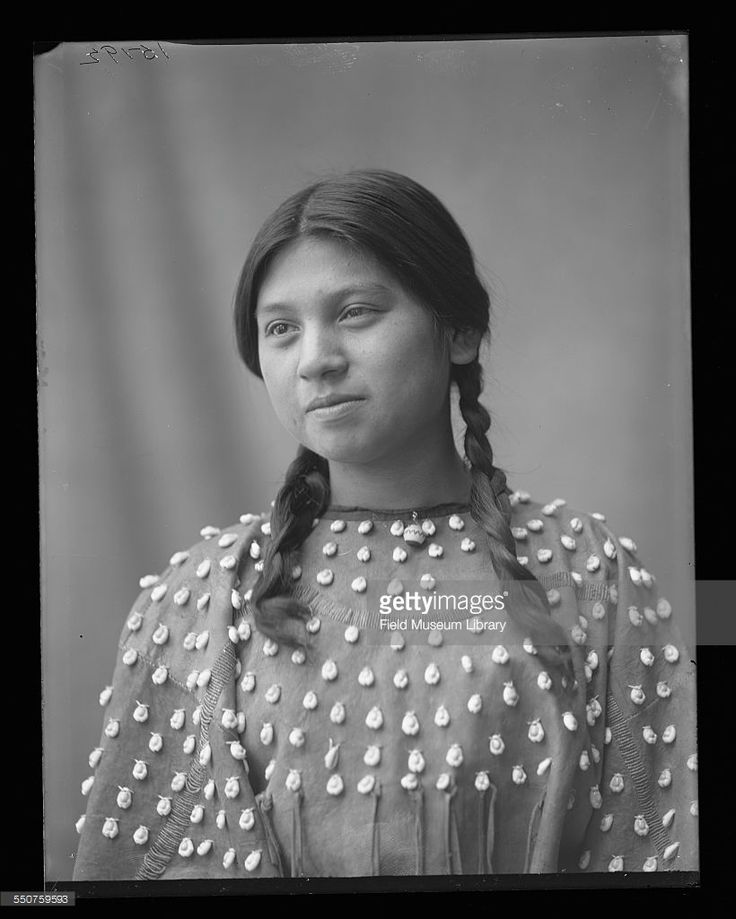 Portrait of Lena Cayuga, a young Native American Seneca woman, aged 17 years, wearing her hair in braids at the Louisiana Purchase Exposition, St Louis, Missouri, June 6, 1904. She studied Domestic Science at the US Indian School and is from the (Bureau of Indian Affairs) Chilocco Indian School in Oklahoma.