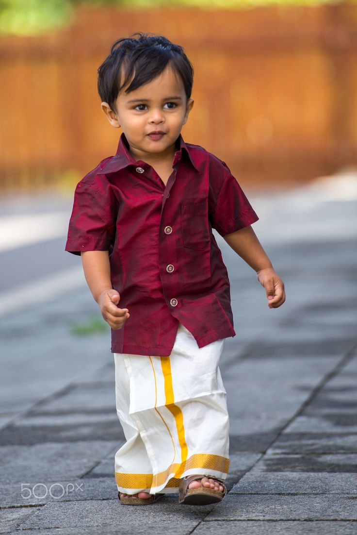 Micro Fashion - A child dressed up in traditional kerala outfit as part of the Onam Festival celebrations