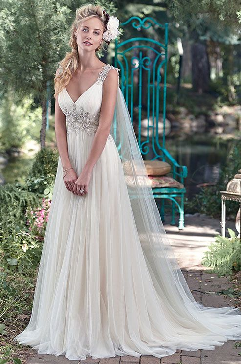 Romance is found in this stunning tulle sheath dress with plunging neckline and sparkling Swarovski crystal embellishment at the waist. Maggie Sottero, Spring 2016
