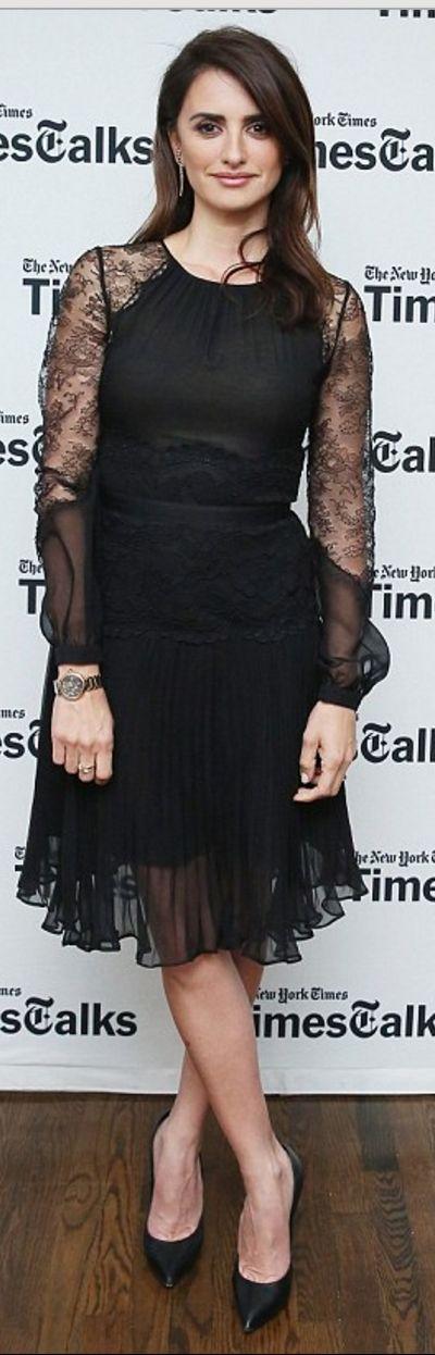 Penelope Cruz's black pumps and lace long sleeve dress