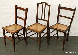 Three cane seat bedroom chairs of varying design 35¾in(91cm)H and smaller.