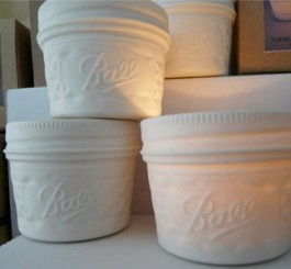 "Porcelain/transclucent mason ""Ball jar"" replica that glows with a votive candle. Neat."