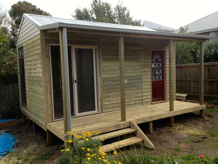 This customer customised their studio with their own timber door and a window on the side!