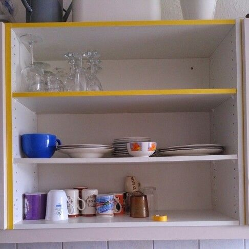 Decorating the kitchen cabinets with yellow washi tape