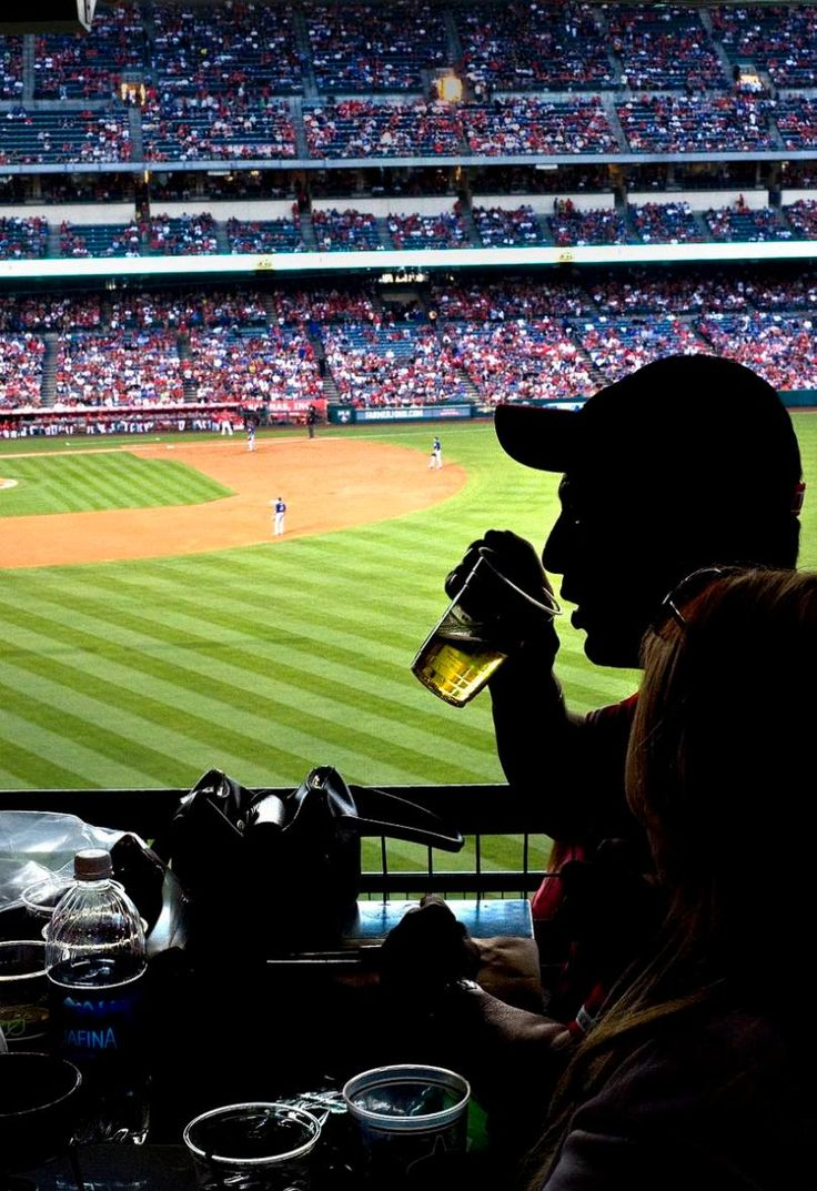 An Angels fan sips a beer at the Shock Top Brew Pub overlooking right field at Angel Stadium during a preseason game against the Dodgers on Saturday.