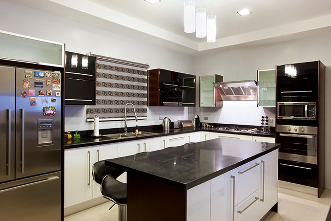 Black, known for its classic and timeless appeal, is the color scheme of the kitchen.