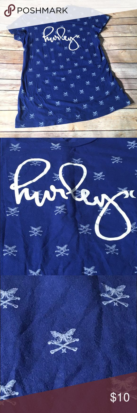 Hurley Womens Blue Graphic T-Shirt Size Large Hurley Womens Cursive Logo On Graphic T-Shirt  Has Hurley wrote in White Cursive Writing on the front along with Butterfly Crossbones Color: Royal Blue   Size:  Large 100% Cotton  Made in Mexico Excellent Used Condition  Code: 17AL03 Hurley Tops Tees - Short Sleeve