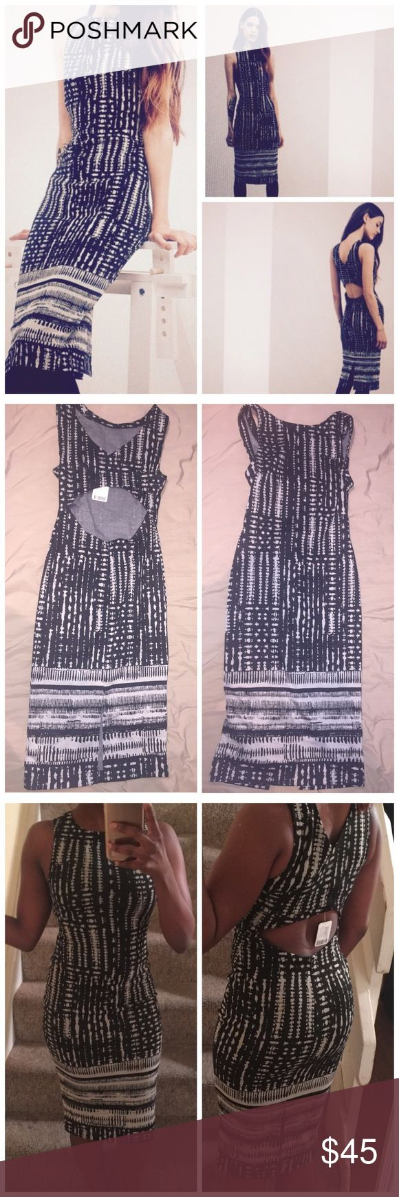 NWT Silence + Noise Midi Dress Black motif dress with cream beige pattern and open back. Perfect condition, NWT. 67% polyester, 32% rayon, 1% spandex. Size is XS. May fit a Small silence + noise Dresses