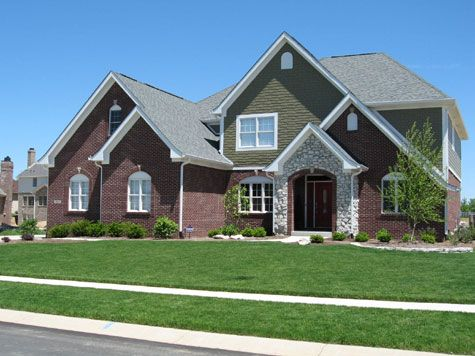 Brown Brick House Luxury Home Features Brick Shake Siding Stone Archway Entrance