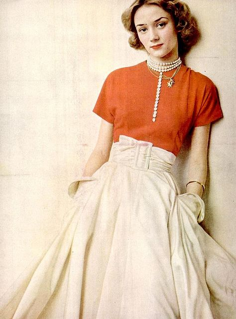 French deb Niki De Saint-Phalle (future sculptor, painter and filmmaker) here in Ceil Chapman's red jersey sweater worn with wide silk taffeta skirt, photo by Arnold Newman for LIFE, Sept. 1949