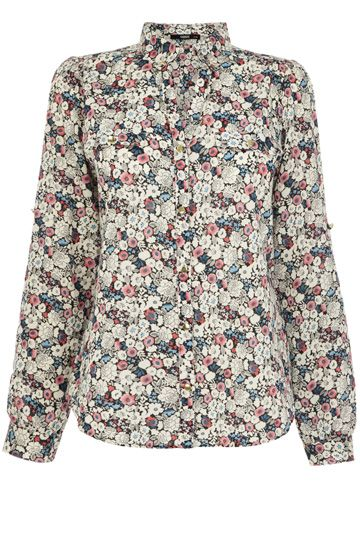 This lightweight cotton shirt is the perfect easy breezy addition to your spring wardrobe. The piece features a pretty ditsy floral print across the fabric and has a open v neckline, The piece is finished with concealed button fastenings on the lapel.