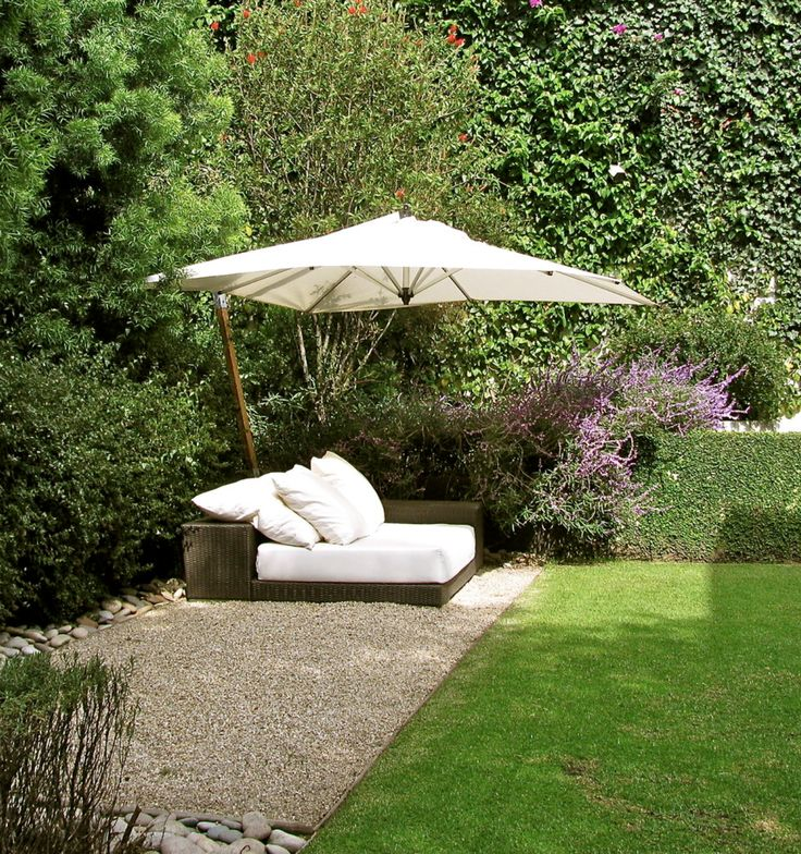 pea gravel, lined with large rocks. lounge chair with large umbrella - could give a little privacy.