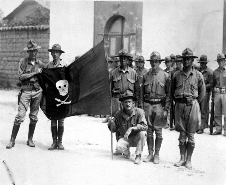 Banana Wars: US Marines with the captured flag of Augusto Cesar Sandino. Nicaragua 1932.