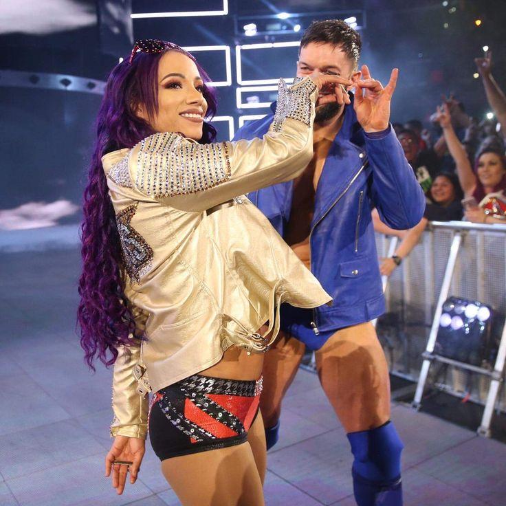 Sasha Banks and Finn Balor