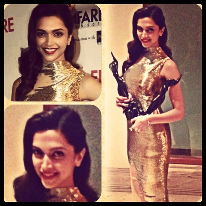 The gorgeous gold lady with the prestigious black lady...  Here is an exclusive picture of Deepika Padukone holding the Filmfare Award for Best Actress 2014 for Goliyon Ki Raasleela: Ram-Leela!